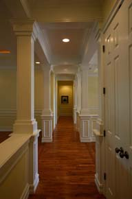 Dream Home Plans, custom home hallway design with architectural trim work, cinnamon hill estates