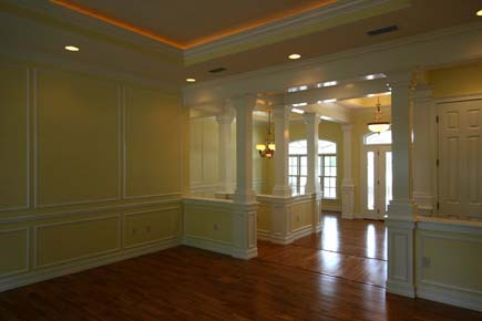 Traditional House Plans, custom home living room design, picture molding trim, wood flooring