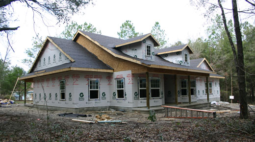 Newberry Architect, photo of custom home under construction, wood framed exterior walls