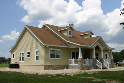 High Springs Architect, country home design with raised front porch, split pitch roof and dormers