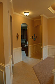 Gainesville FL Architect, custom home hallway design with crown molding and wainscoting, arches