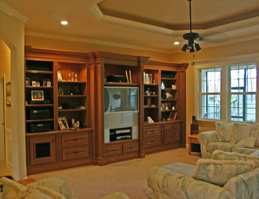 Architectural Designers, living room built-in entertainment center designed by florida architect